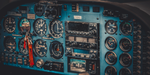 vintage-aircraft-cockpit-detail-retro-aviation-PXEEDXW-featured